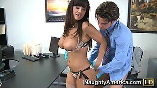 Busty brunette Lisa Ann pokes her boss after work