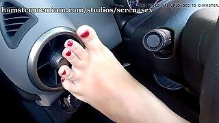Fötter retsticka i bil