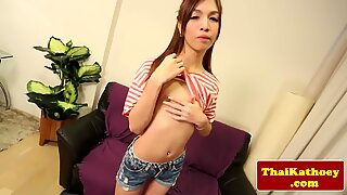 Thai skinny ladyboy with braces jerks herself